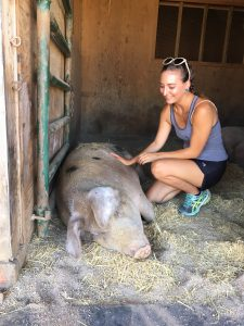 ParkerColleen-VG18-with-pig-at-Farm-Sanctuary-225x300